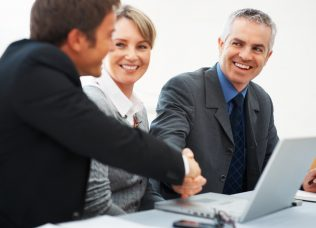Business man shaking hands with colleague